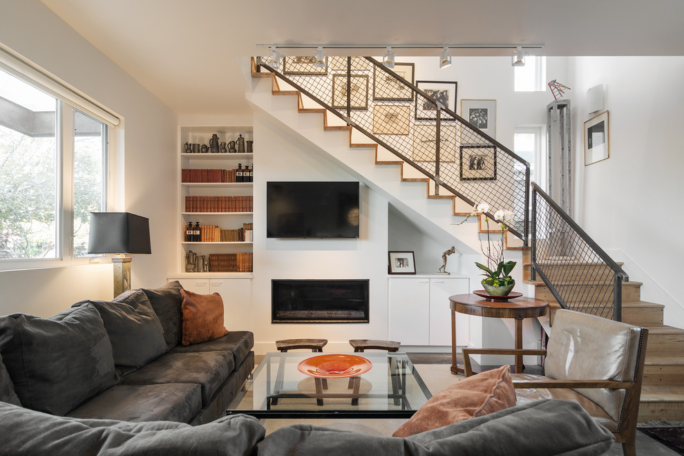 Inspiration for a contemporary living room remodel in Salt Lake City with a ribbon fireplace, a plaster fireplace, a wall-mounted tv and white walls