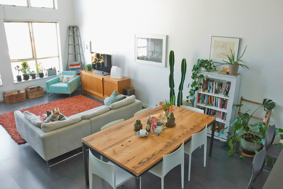 Example of an eclectic living room design in Vancouver with white walls