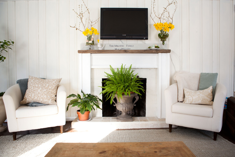 Living room - traditional living room idea in Boston with a standard fireplace and a wall-mounted tv