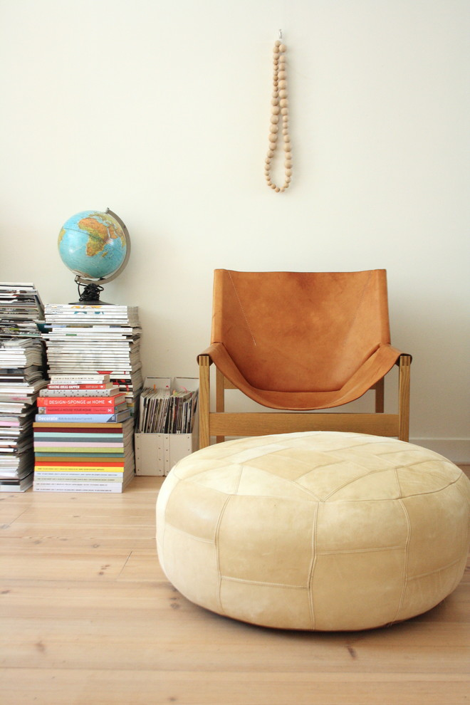 Inspiration for an eclectic living room library remodel in Amsterdam with white walls