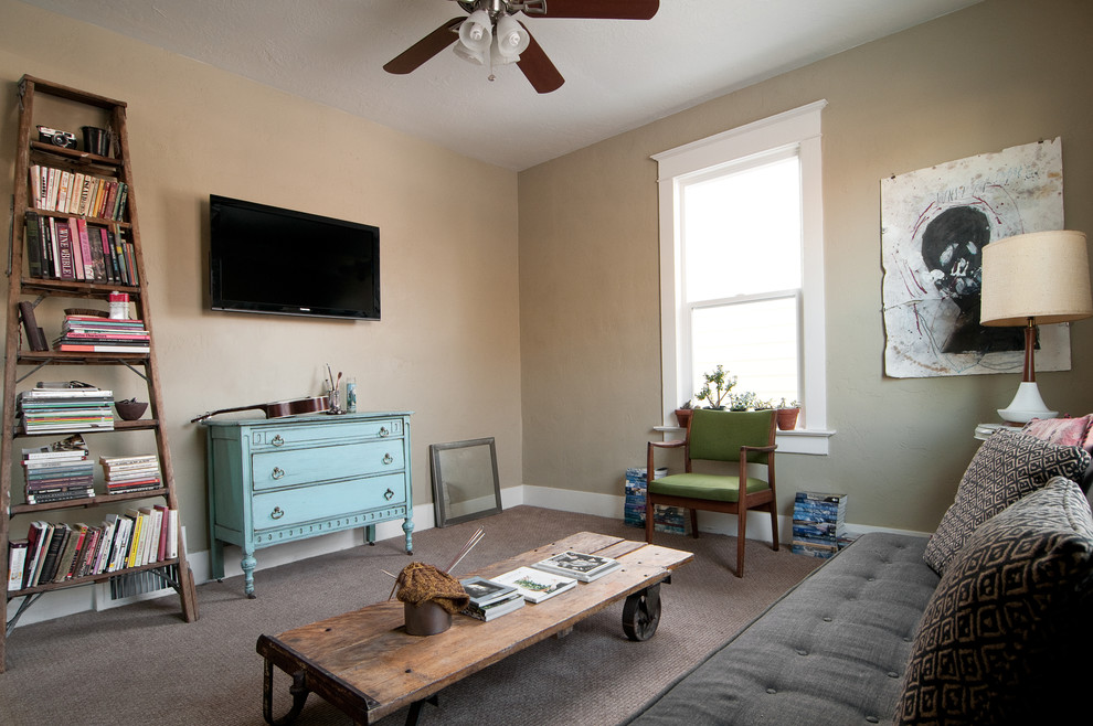 Trendy enclosed carpeted living room photo in Salt Lake City with beige walls and a wall-mounted tv