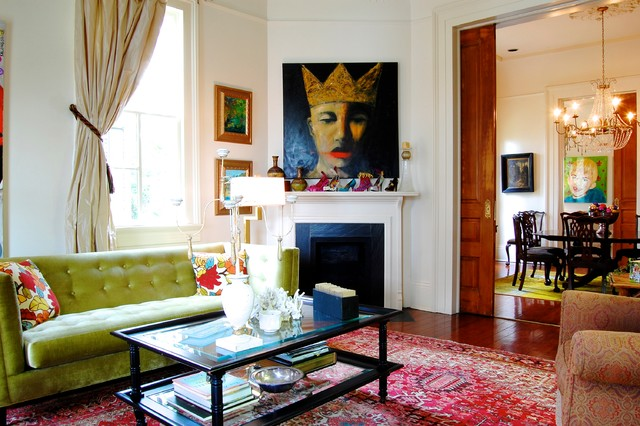 ornate living room photo in new york with white walls and a corner fireplace