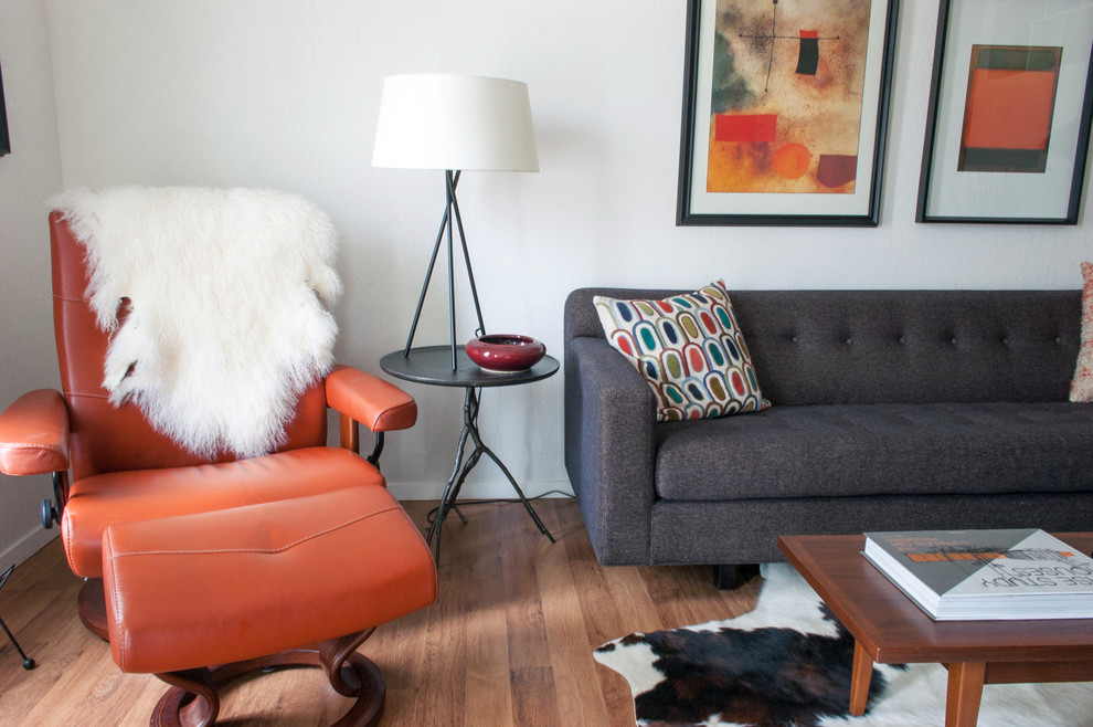 Inspiration for a 1950s medium tone wood floor living room remodel in Dallas with white walls