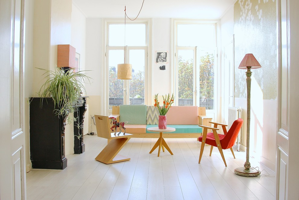 This is an example of a scandinavian living room in Amsterdam with white walls and white floor.