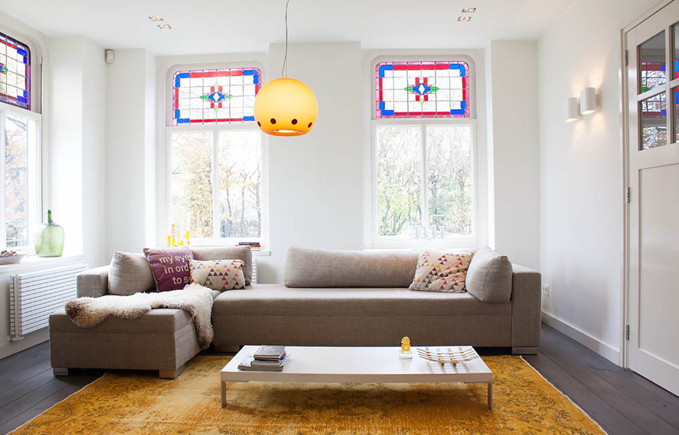 Trendy living room photo in Amsterdam with white walls