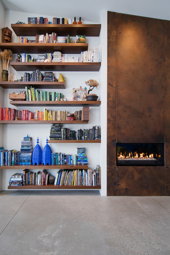 Inspiration for a contemporary concrete floor living room remodel in Salt Lake City with a metal fireplace