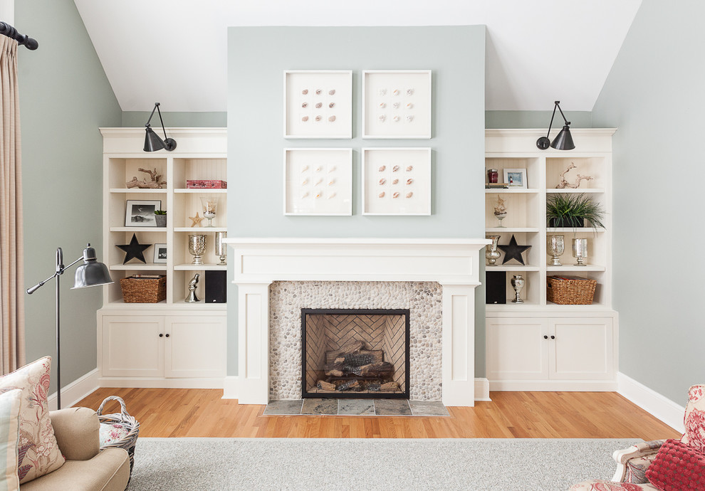 Living room - transitional medium tone wood floor living room idea in Other with a standard fireplace