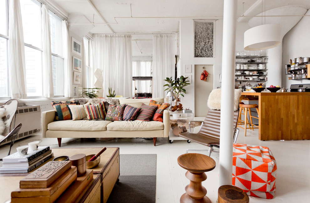 Inspiration for an eclectic open concept living room remodel in New York with white walls