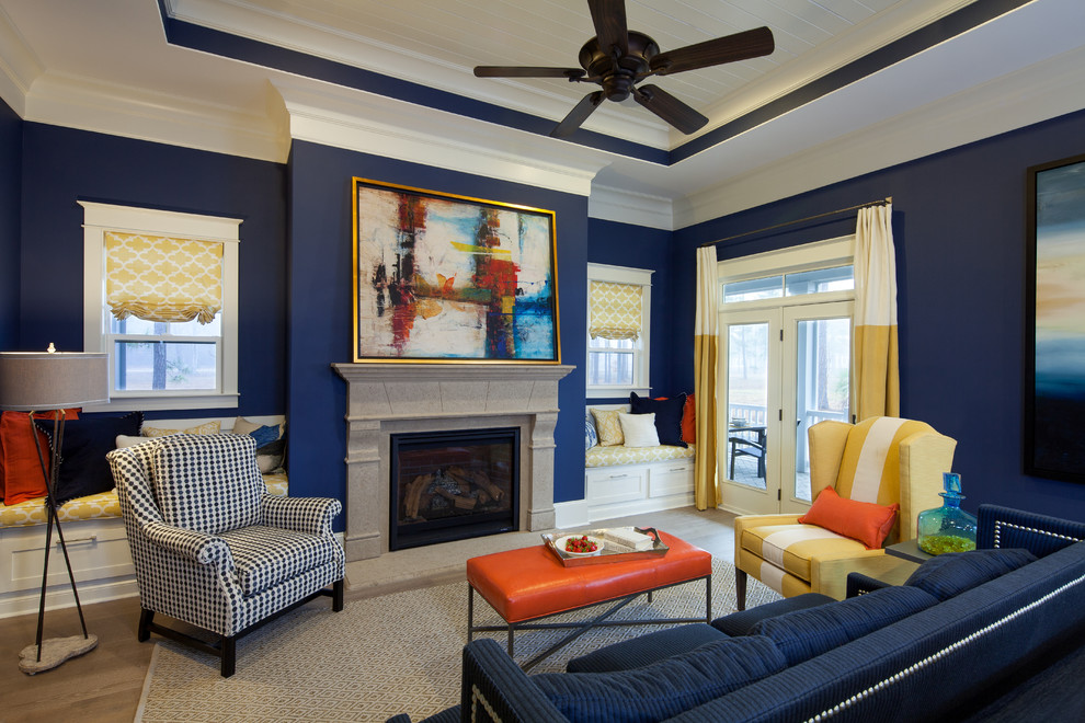 Inspiration for a contemporary light wood floor living room remodel in Boise with blue walls and a standard fireplace