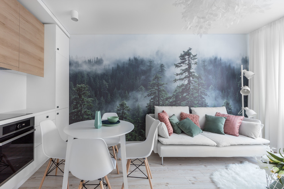 Inspiration for a scandinavian open concept beige floor and light wood floor living room remodel in Other with white walls