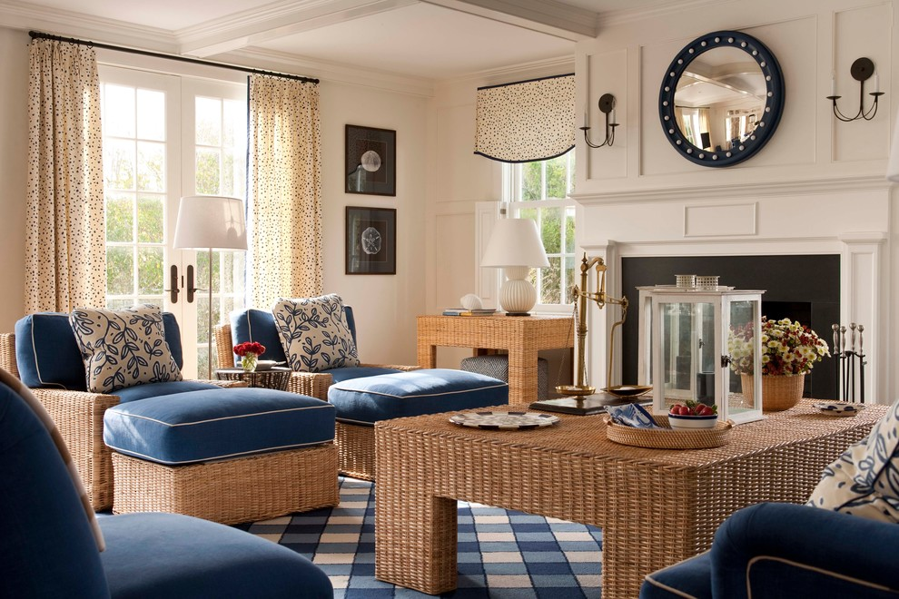Example of a mid-sized beach style enclosed carpeted living room design in Boston with white walls, a standard fireplace and a metal fireplace