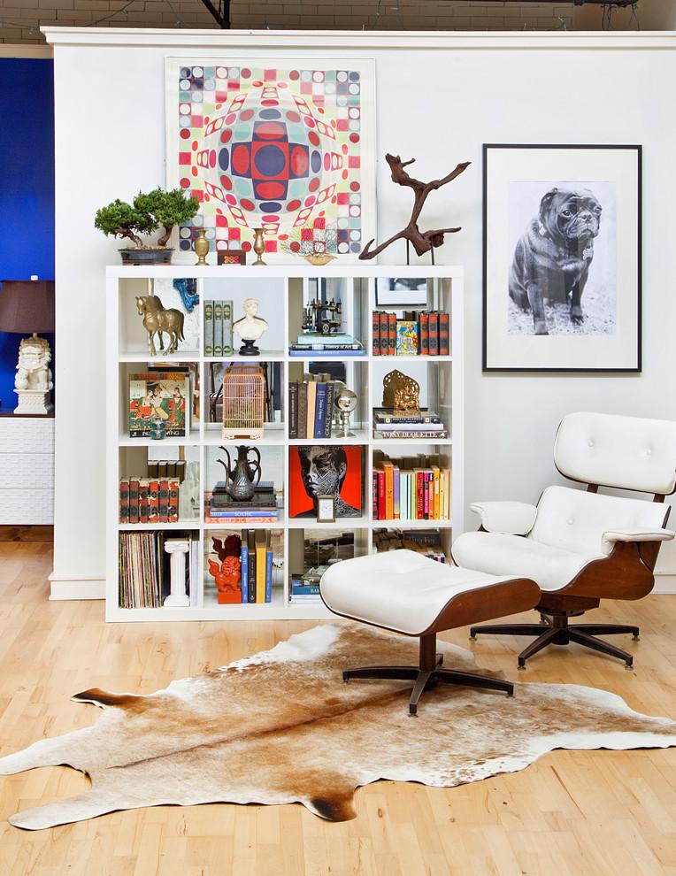 Living room - eclectic light wood floor living room idea in Philadelphia with white walls