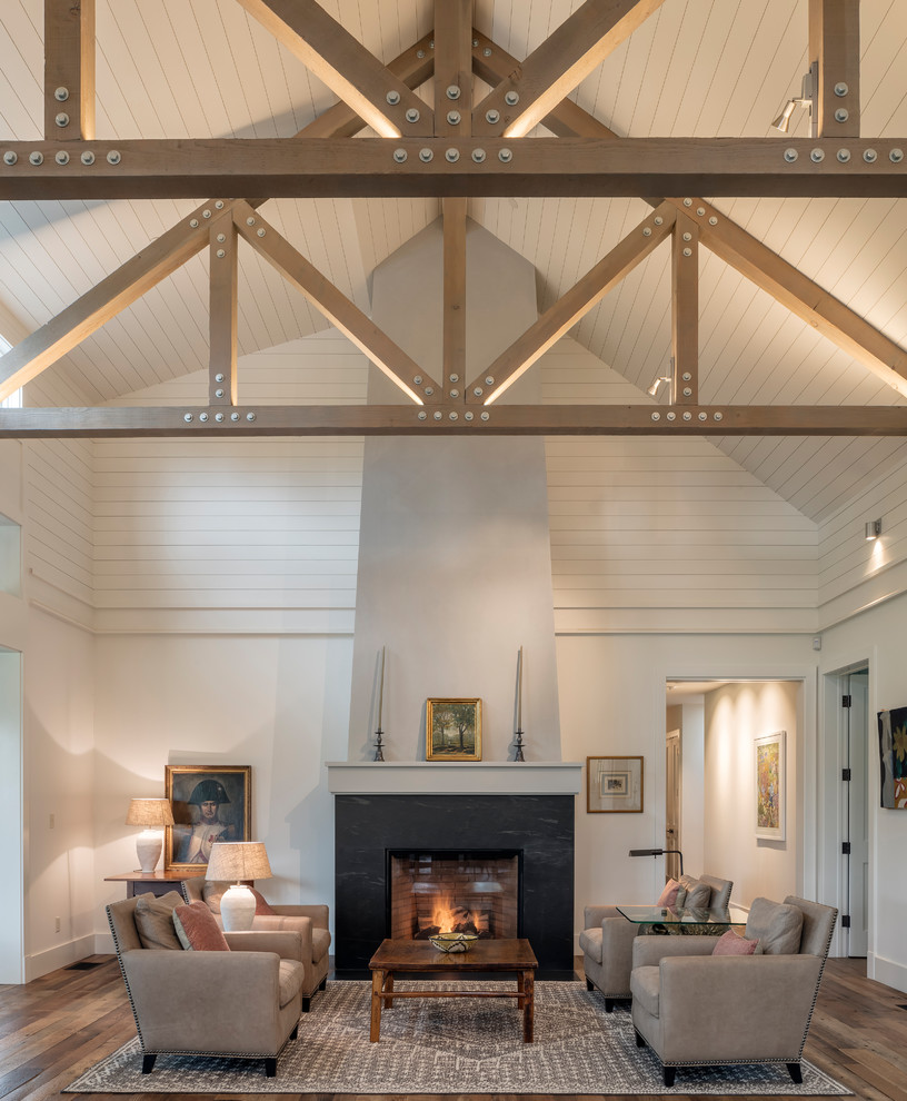 Inspiration for a farmhouse dark wood floor and brown floor living room remodel in San Francisco with white walls and a standard fireplace
