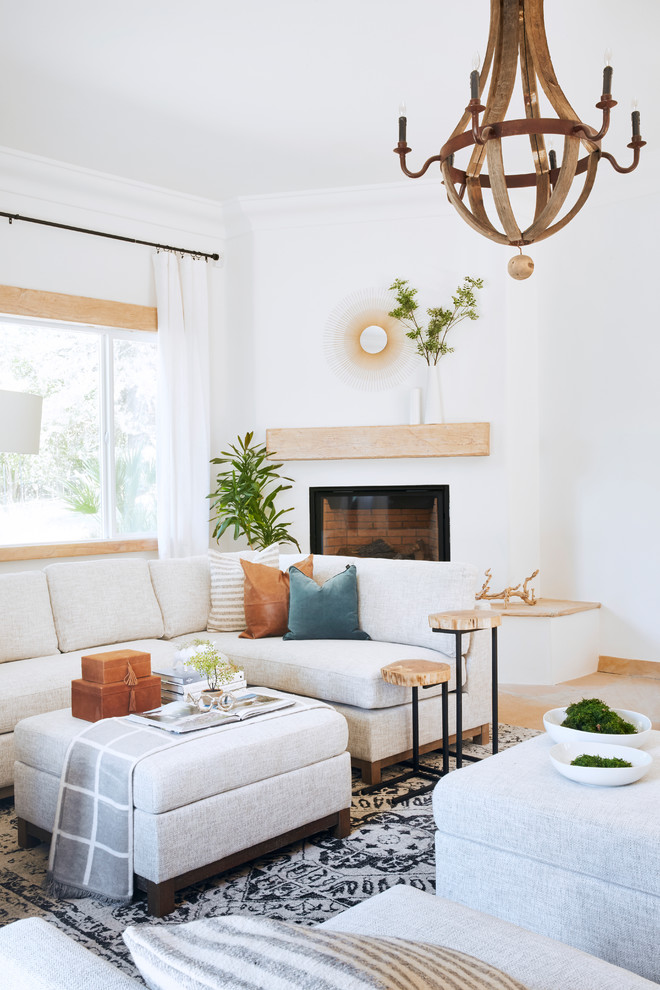 Living room - large mediterranean open concept slate floor and brown floor living room idea in Phoenix with white walls, a corner fireplace and a plaster fireplace