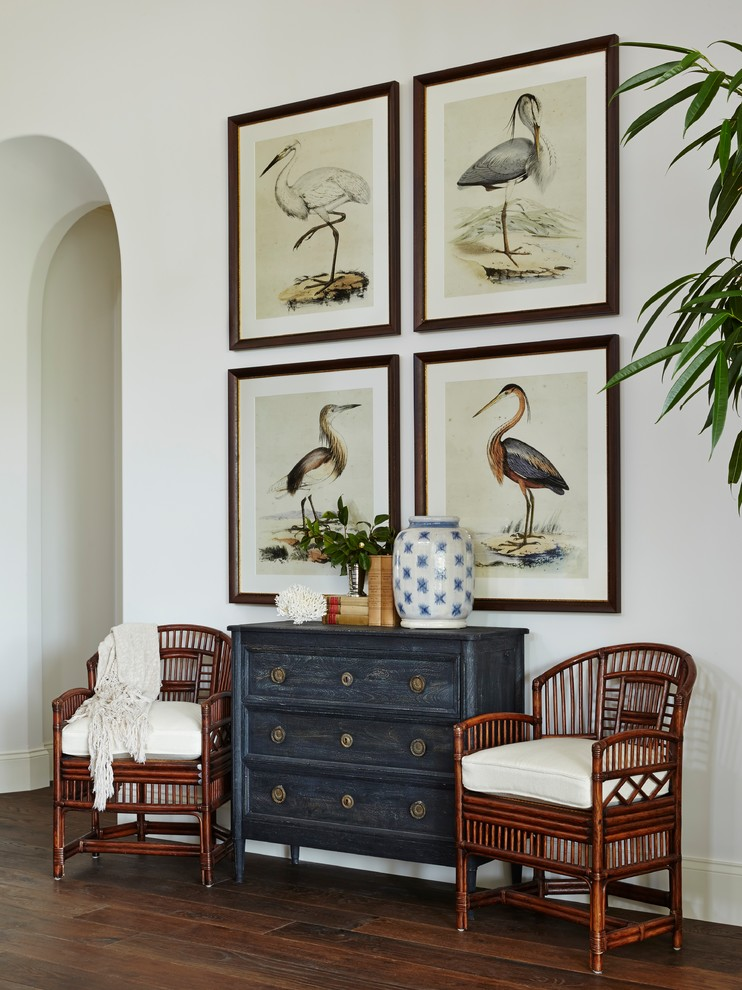 Inspiration for a huge tropical open concept medium tone wood floor living room remodel in Miami with white walls and no tv