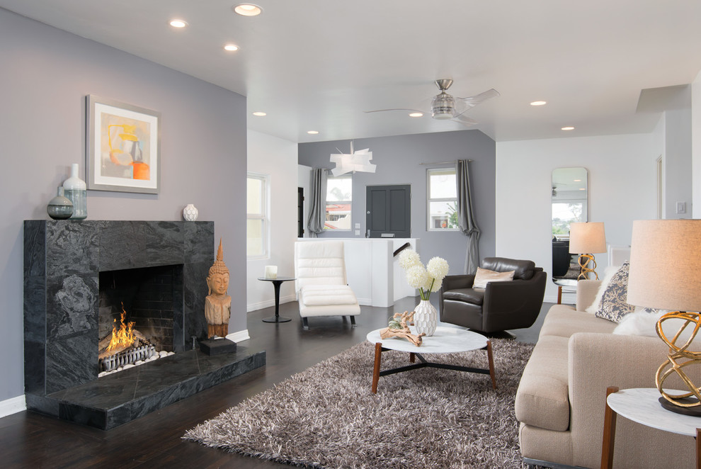 Inspiration for a contemporary open concept dark wood floor living room remodel in San Diego with gray walls, a standard fireplace and a stone fireplace