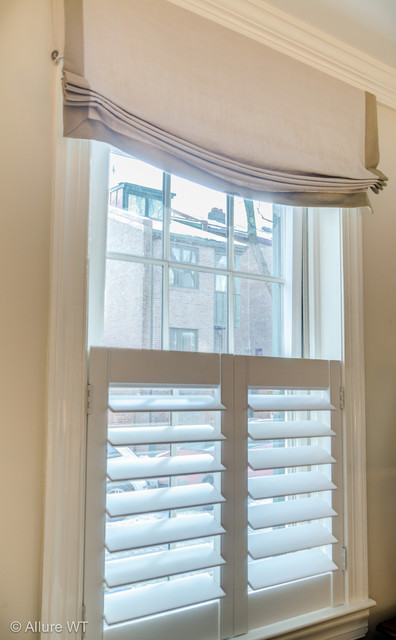 Natural Light And Privacy Achieved With Cafe Style Shutter Roman Shade