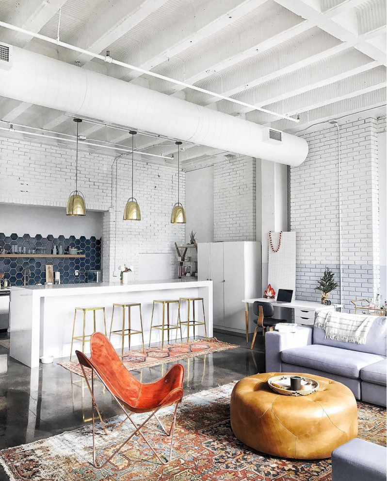 Example of a large urban open concept concrete floor living room design in San Francisco with white walls