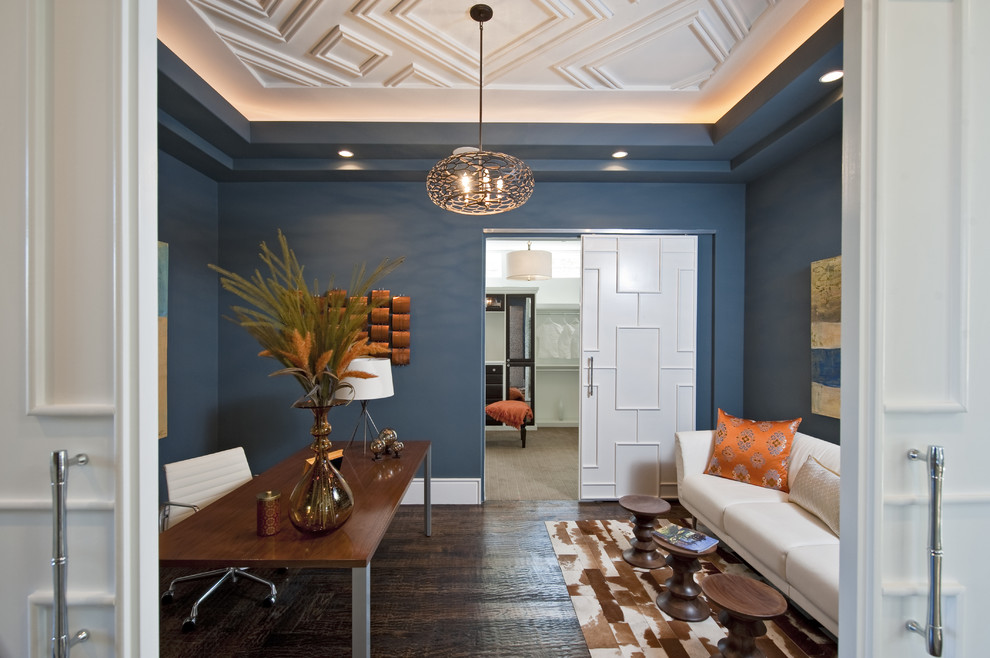 Mid-sized transitional enclosed dark wood floor and brown floor living room photo in Austin with blue walls, no fireplace and no tv