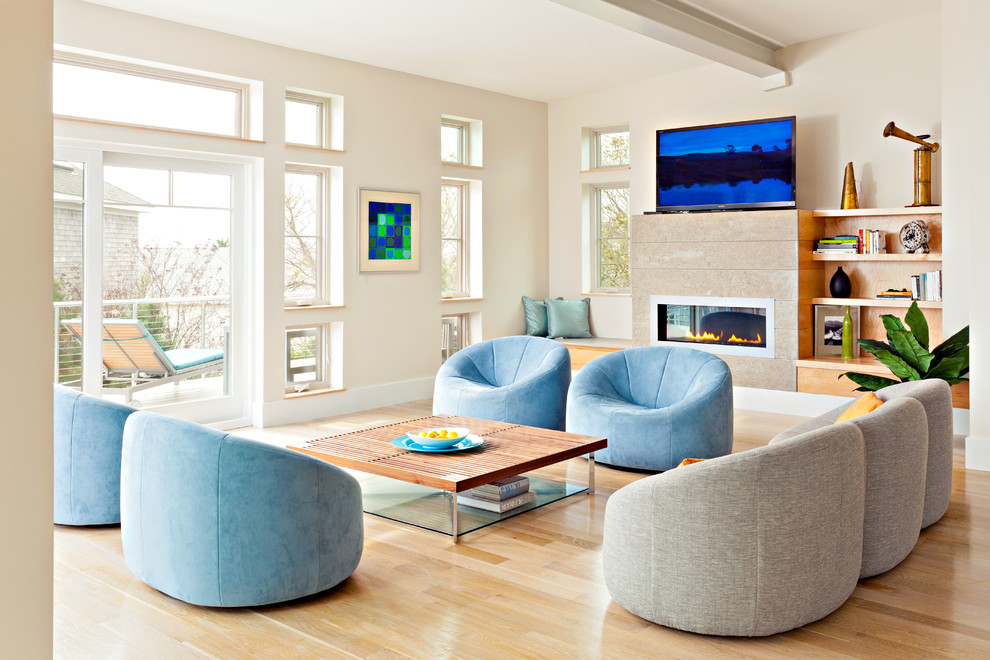 Example of a large minimalist light wood floor living room design in Boston with a ribbon fireplace and a tv stand