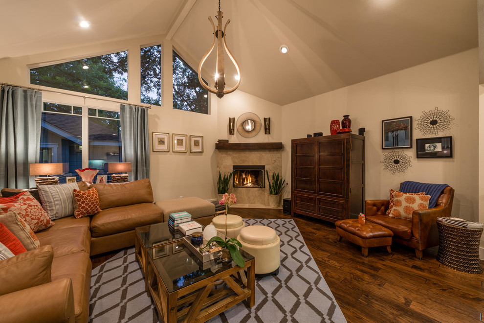 Inspiration for a contemporary living room remodel in Austin with a corner fireplace and a tile fireplace