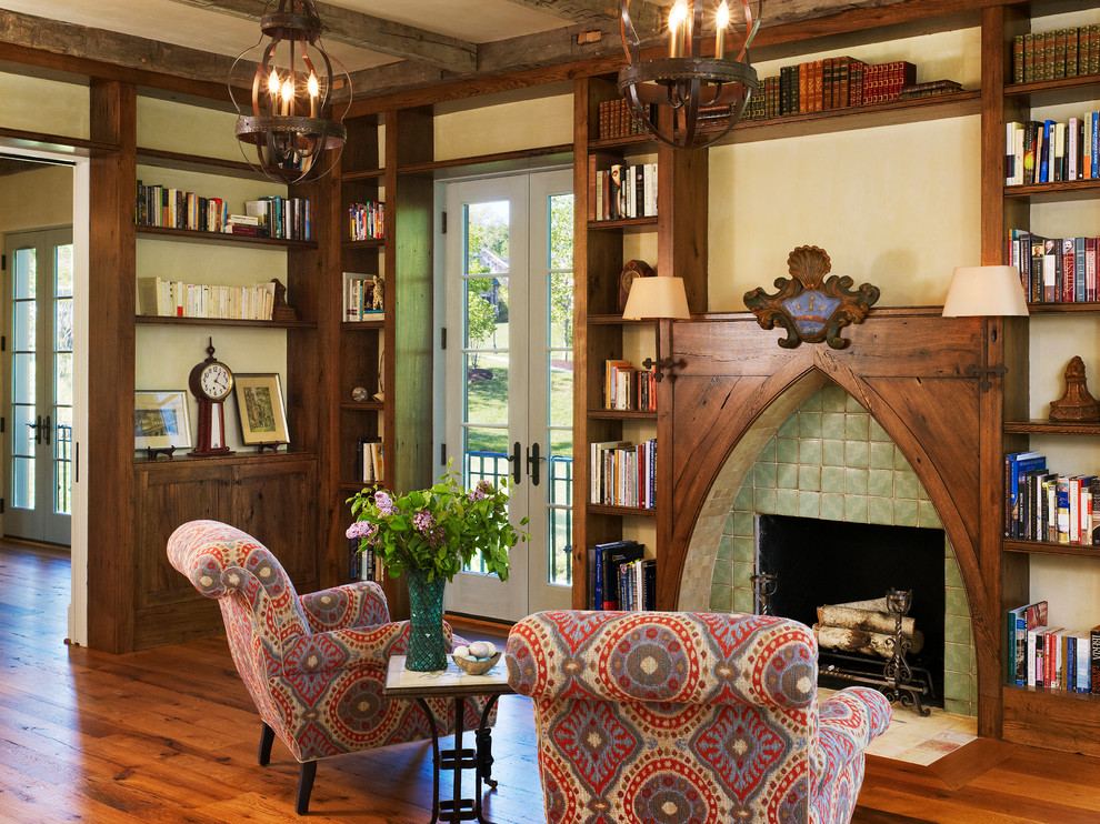 Inspiration for a mediterranean dark wood floor living room library remodel in DC Metro with a standard fireplace and a tile fireplace