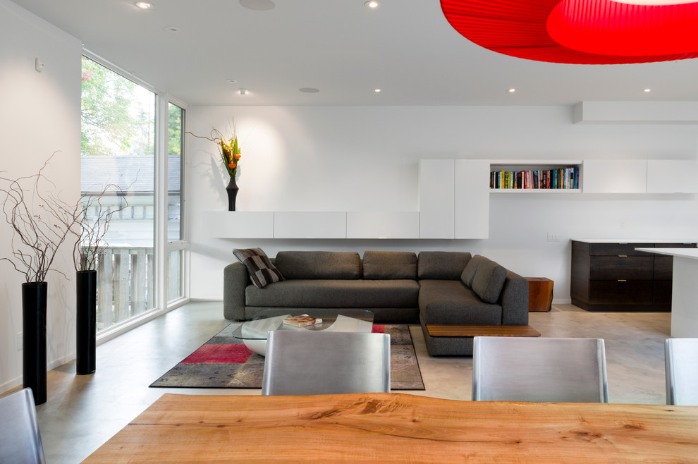 Trendy concrete floor living room photo in Ottawa with white walls