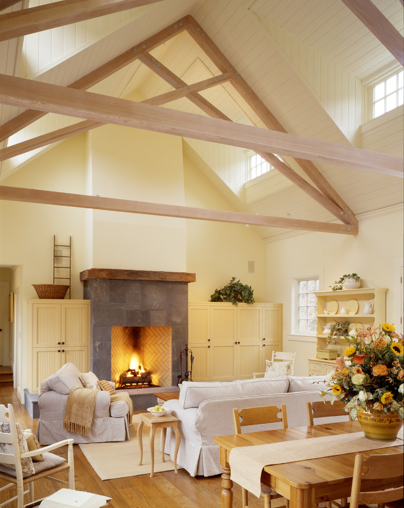 Living room - huge country open concept and formal medium tone wood floor living room idea in San Francisco with yellow walls, a standard fireplace, a tile fireplace and a media wall