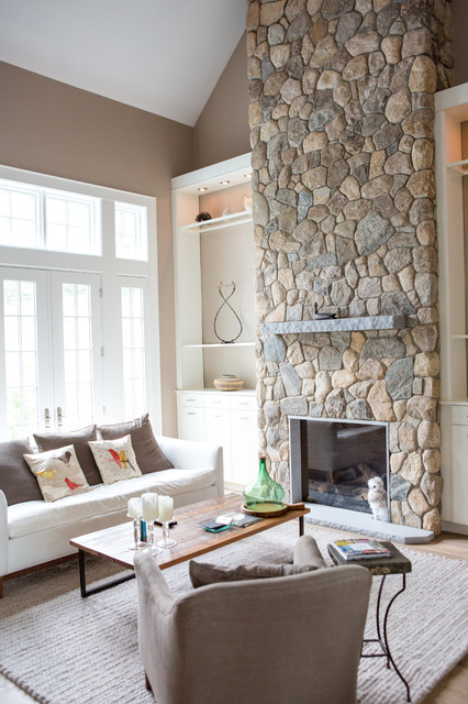 Inspiration for a mid-sized timeless formal and open concept carpeted and brown floor living room remodel in Boston with beige walls, a standard fireplace, a stone fireplace and no tv