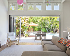 New family room opening to the pool midcentury-family-room