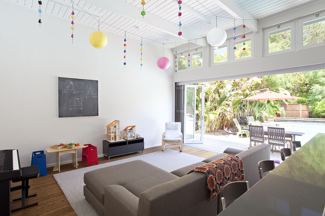 example of a 1960s open concept medium tone wood floor family room design in san francisco - Living Room Decorating Ideas Kid Friendly