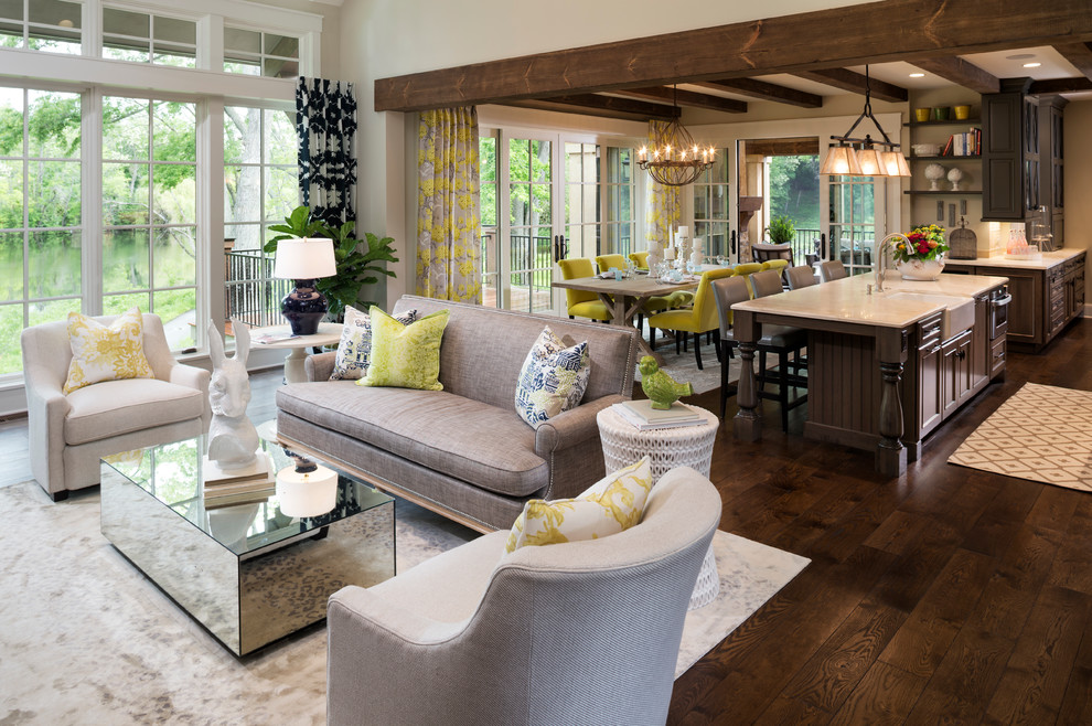 Inspiration for a large transitional open concept and formal dark wood floor and brown floor living room remodel in Minneapolis with beige walls, a standard fireplace and a stone fireplace