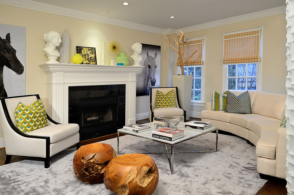 Eclectic living room photo in Toronto with beige walls and a standard fireplace