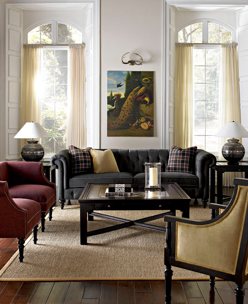 Example of a trendy formal dark wood floor living room design in Other with white walls and no tv