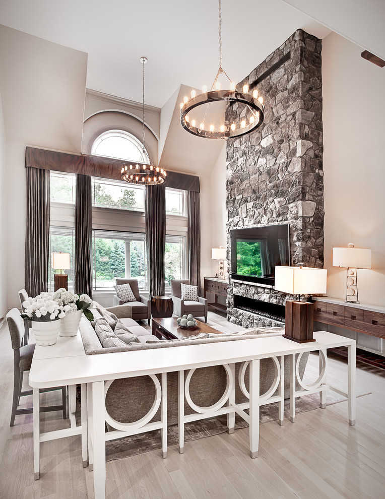 Huge transitional open concept light wood floor living room photo in New York with gray walls, a ribbon fireplace, a stone fireplace and a wall-mounted tv