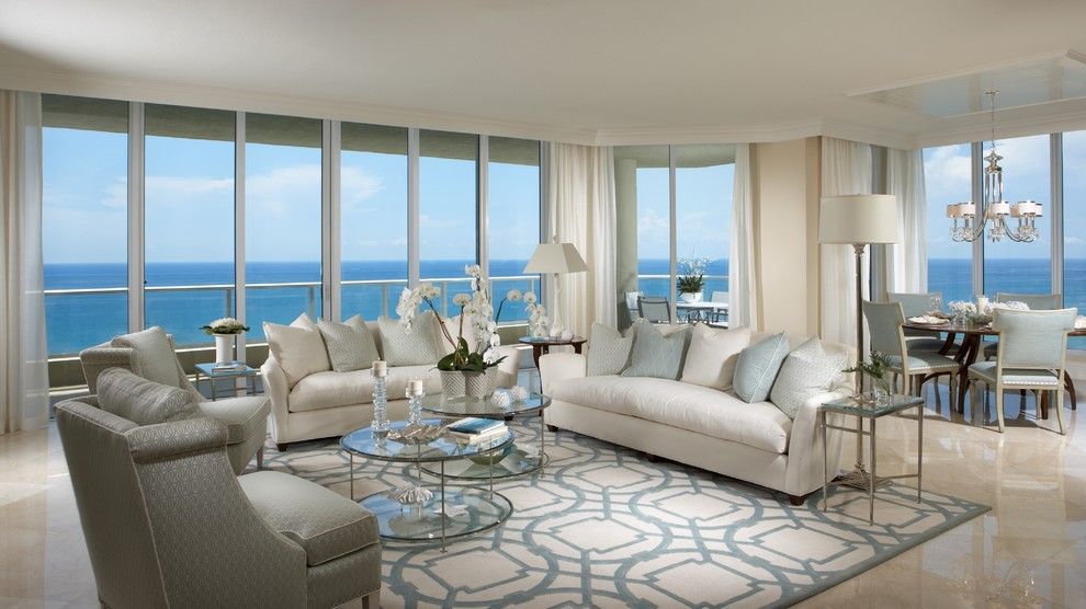Design ideas for a large nautical living room in Miami with beige walls and marble flooring.