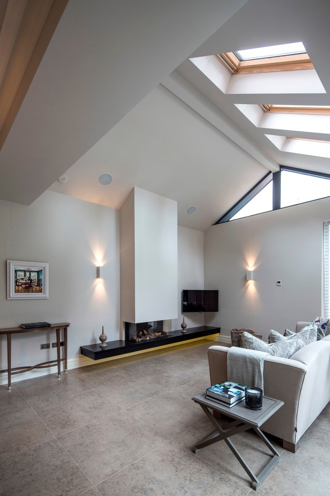 Trendy open concept living room photo in London with white walls, a ribbon fireplace and a wall-mounted tv