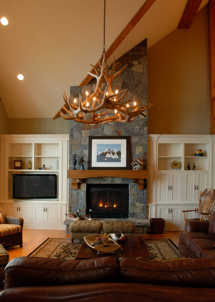 Inspiration for a large contemporary formal and open concept medium tone wood floor living room remodel in Boston with beige walls, a standard fireplace, a stone fireplace and a tv stand