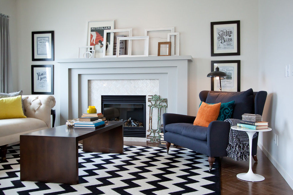 Example of a transitional formal living room design in Calgary with white walls