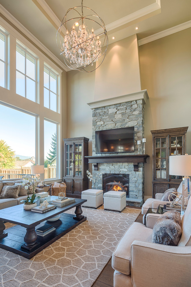 Inspiration for a mid-sized timeless open concept dark wood floor living room remodel in Vancouver with beige walls, a standard fireplace, a stone fireplace and a wall-mounted tv
