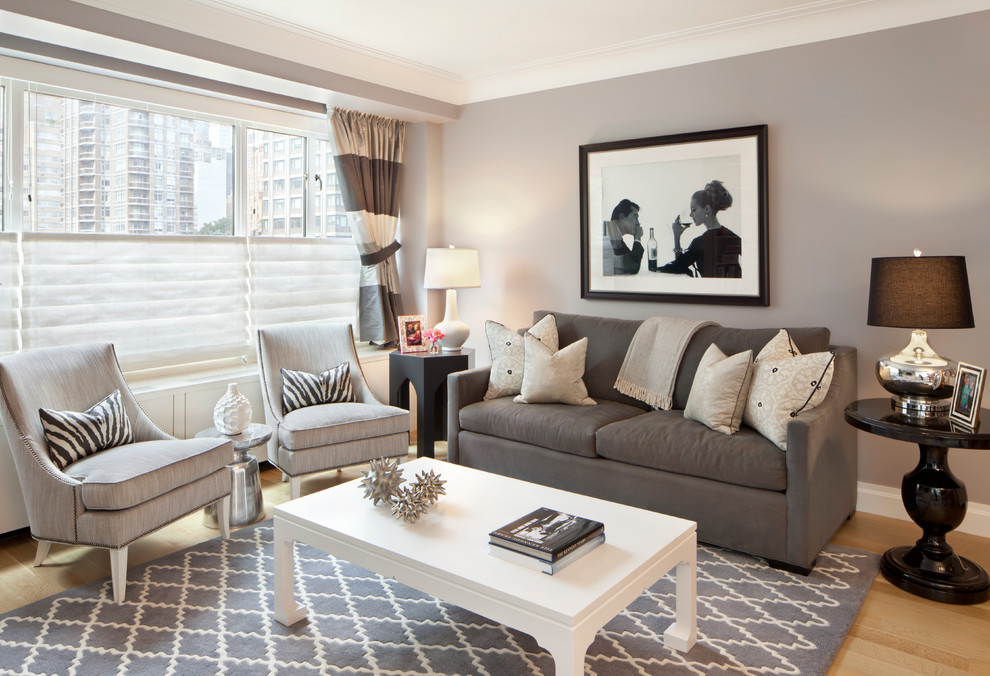 Inspiration for a small transitional open concept light wood floor living room remodel in New York with gray walls