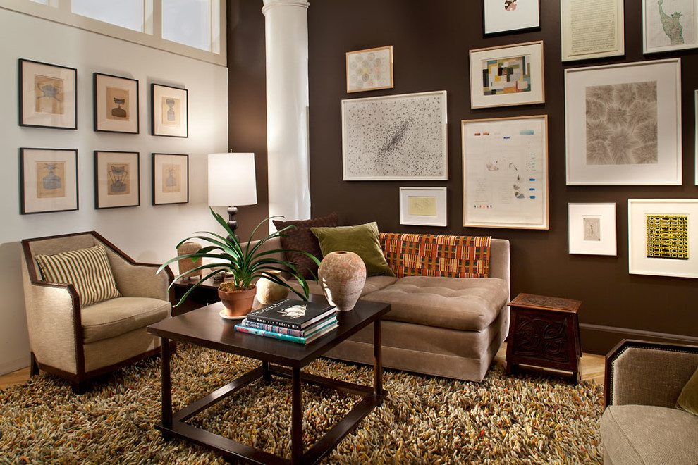 Example of a trendy living room design in New York with brown walls