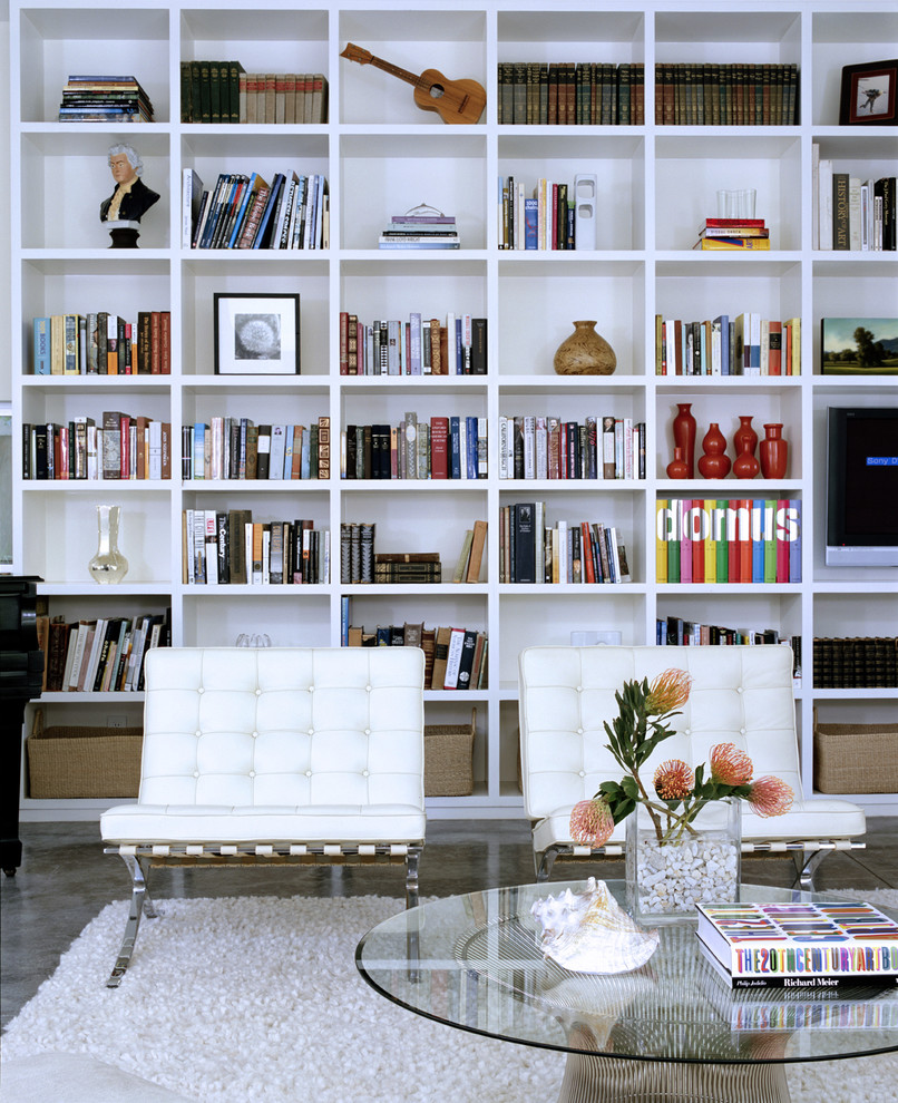 Mid-sized minimalist open concept concrete floor and gray floor living room library photo in Los Angeles with white walls, a standard fireplace, a tile fireplace and no tv