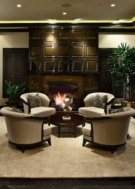 Example of a mid-sized transitional formal dark wood floor living room design in Orange County with a standard fireplace and beige walls