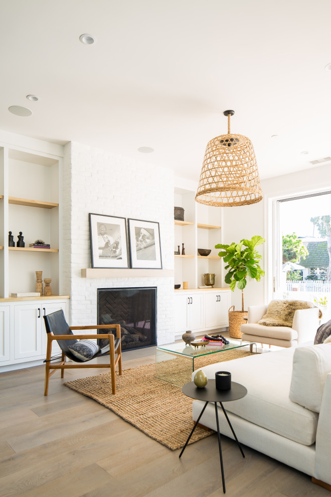 Living room - mid-sized cottage open concept light wood floor living room idea in Orange County with a standard fireplace and a brick fireplace