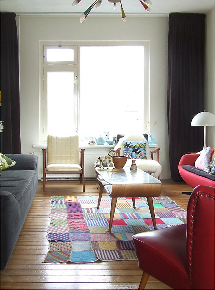 Living room - eclectic medium tone wood floor living room idea in Amsterdam