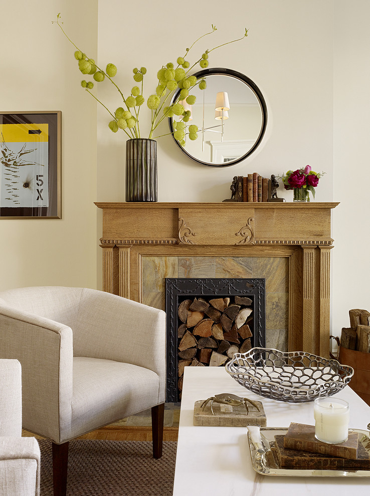 Transitional living room photo in San Francisco with a standard fireplace
