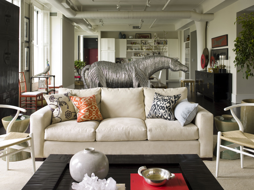 Eclectic open concept living room photo in New York with white walls