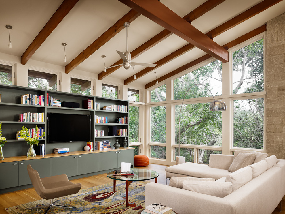 Living room - modern living room idea in Austin with a wall-mounted tv