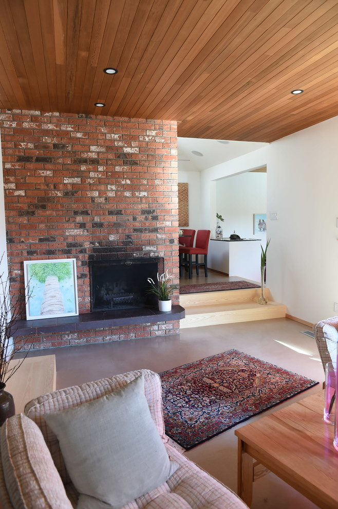Inspiration for a mid-sized contemporary open concept and formal cork floor and beige floor living room remodel in Vancouver with white walls, a standard fireplace and a brick fireplace